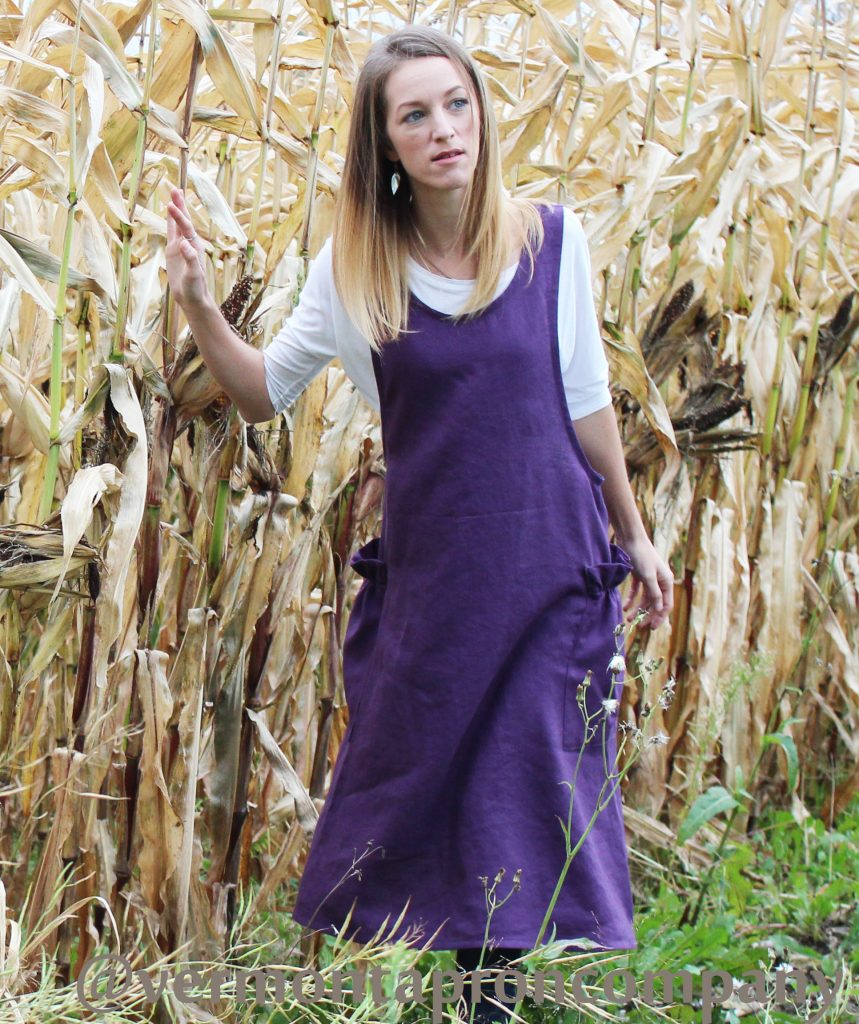 deep purple linen aprons with criss cross straps and big ruffled pockets.