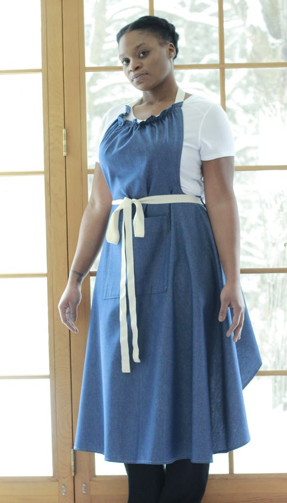 The Vermont Apron Company's new Long Bib Apron in denim. The ruffled top stops the bib from gaping.